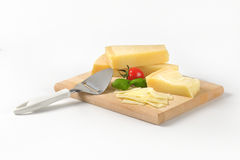 Parmesan cheese and cheese knife Stock Images