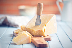 Parmesan cheese on cutting board Stock Images