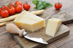 Parmesan cheese on cutting board Royalty Free Stock Photography