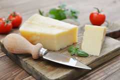 Parmesan cheese on cutting board Stock Image