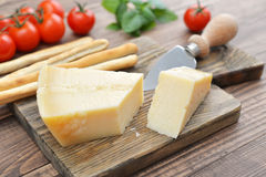 Parmesan cheese on cutting board Stock Photos