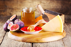 Parmesan cheese with fresh figs and honey Stock Photos