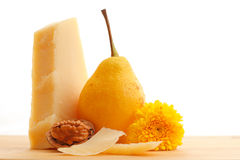 Parmesan cheese and fruits Royalty Free Stock Photography