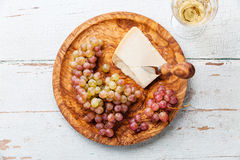 Parmesan cheese and grapes Stock Photo