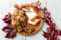 Parmesan cheese and grapes Stock Images