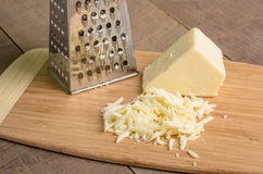 Parmesan cheese grated on a cutting board Royalty Free Stock Images
