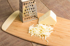 Parmesan cheese grated on a cutting board Royalty Free Stock Photography