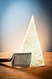 Parmesan cheese with a grater Stock Image