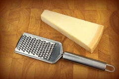 Parmesan cheese and grater Stock Photo