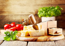 Parmesan cheese. With grater on wooden background stock images