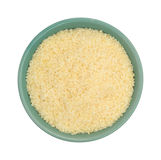 Parmesan cheese in a green bowl. Top view of a green bowl filled with freshly grated parmesan cheese on a white background Stock Image