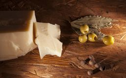 Parmesan cheese and green olives Royalty Free Stock Images