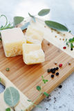 Parmesan cheese with herbs Royalty Free Stock Photos