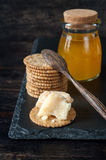 Parmesan cheese with honey and crispy cookies Stock Image