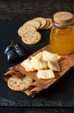 Parmesan cheese with honey, grapes and cookies Stock Photos