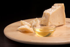 Parmesan cheese and honey Royalty Free Stock Photos