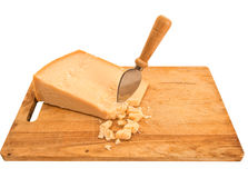 Parmesan cheese with knife on old wooden board, isolated over wh Royalty Free Stock Photos