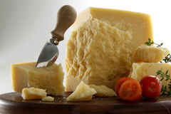 Parmesan cheese with knife Royalty Free Stock Images