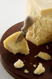 Parmesan cheese with knife Stock Photos