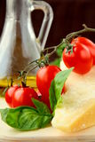 Parmesan cheese olive oil cherry tomatoes Royalty Free Stock Photography