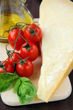Parmesan cheese olive oil cherry tomatoes Royalty Free Stock Photos