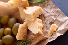 Parmesan cheese and olives Royalty Free Stock Photos