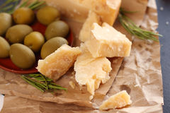 Parmesan cheese and olives Royalty Free Stock Photography