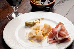 Parmesan cheese  with parma ham Stock Images