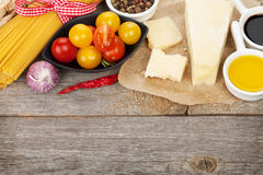 Parmesan cheese, pasta, tomatoes, vinegar, olive oil, herbs and Royalty Free Stock Images