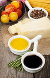 Parmesan cheese, pasta, tomatoes, vinegar, olive oil, herbs and Stock Photo