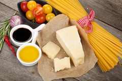 Parmesan cheese, pasta, tomatoes, vinegar, olive oil, herbs and Royalty Free Stock Photo