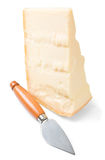 Parmesan cheese piece with knife. Stock Image