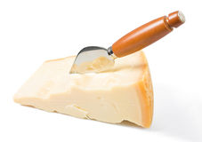 Parmesan cheese piece with knife. Royalty Free Stock Image