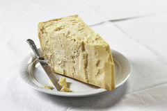 Parmesan cheese. A piece of Parmesan cheese with knife Royalty Free Stock Photography