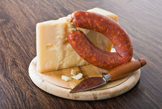 Parmesan cheese piece with spicy sausage. Stock Photography