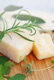 Parmesan cheese with rosemary,close-up Royalty Free Stock Images