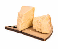Parmesan cheese two stacks on wooden plate isolated on white Royalty Free Stock Photo