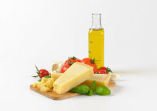 Parmesan cheese, vegetables and olive oil Stock Image