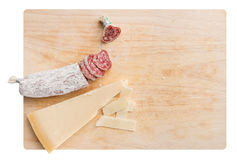 Parmesan cheese wedge and dried salami Stock Photo
