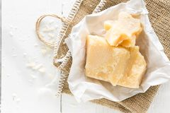 Parmesan cheese on white wooden background. Top view Stock Photography
