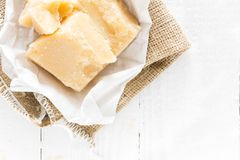 Parmesan cheese on white wooden background Stock Photo
