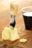 Parmesan cheese and wine on a chopping board Royalty Free Stock Images