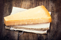 Parmesan Cheese on Wooden Background close up. Piece of Parmesan Royalty Free Stock Photos