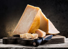 Parmesan cheese. On a wooden board Stock Photo