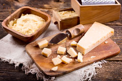 Parmesan cheese on wooden board Royalty Free Stock Photos