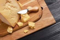 Parmesan cheese on wood. En board royalty free stock photo