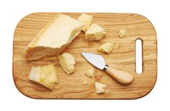 Parmesan cheese on wooden board royalty free stock images