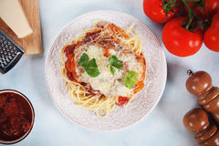 Parmesan chicken with spaghetti pasta. Chicken Parmesan with melted cheese, tomato sauce and spaghetti pasta Royalty Free Stock Photos