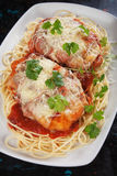 Parmesan chicken with spaghetti pasta. Chicken parmesan with melted cheese, tomato sauce and spaghetti pasta Royalty Free Stock Photography