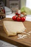 Parmesan on chopping board Royalty Free Stock Photos
